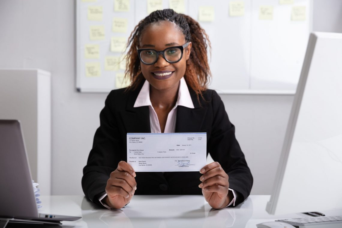 Businesswoman Showing Company Cheque
